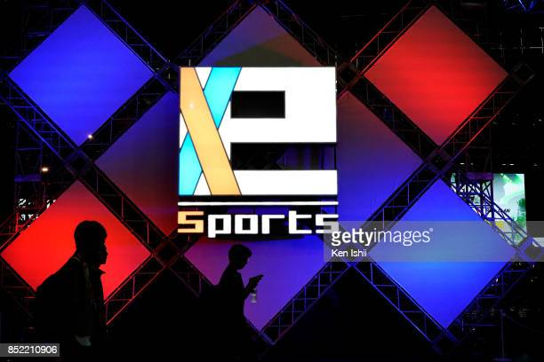 People walk past eSports logo during the Tokyo Game Show 2017 at Makuhari Messe on September 23 2017 in Chiba Japan