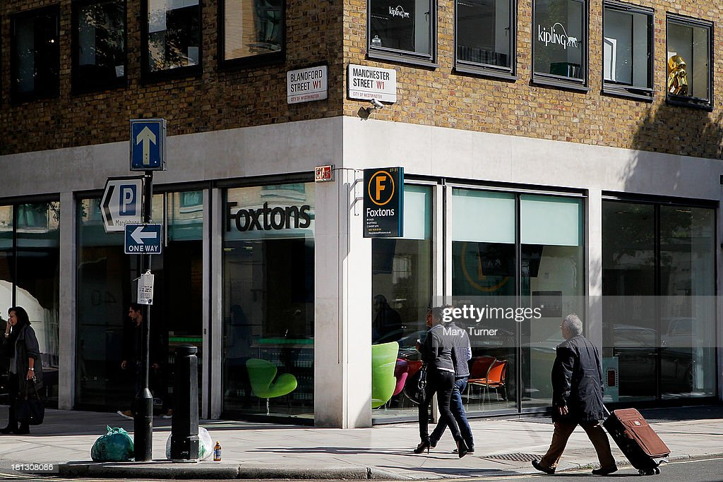 People walk past Foxtons Estate Agents in Marylebone on September 20, 2013 in London, England. Foxtons has been valued at £649 million ahead of its full stock market listing. Shares in the company were priced at GBP 2.30 each.