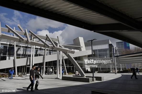 People walk past Google Inc offices inside the Googleplex headquarters in Mountain View California US on Thursday Feb 18 2016 Google part of Alphabet...