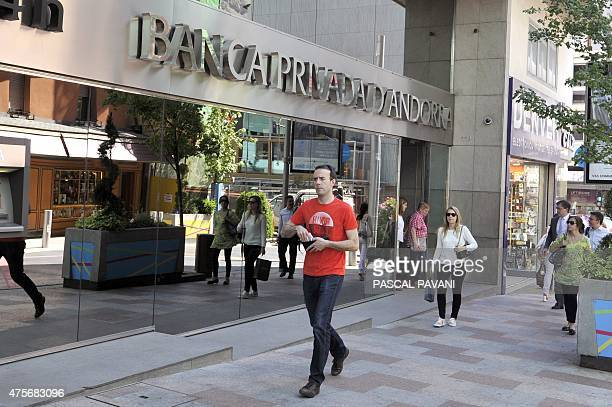 People walk past into a branch of the Banco Privada d'Andorra in Andorra la Vella on May 12 2015 The US Treasury's Financial Crimes Enforcement...
