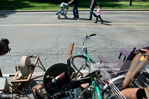 People walk past items for sale during the Got to Be NC Festival at the North Carolina State Fairgrounds on May 20 2017 in Raleigh North Carolina /...