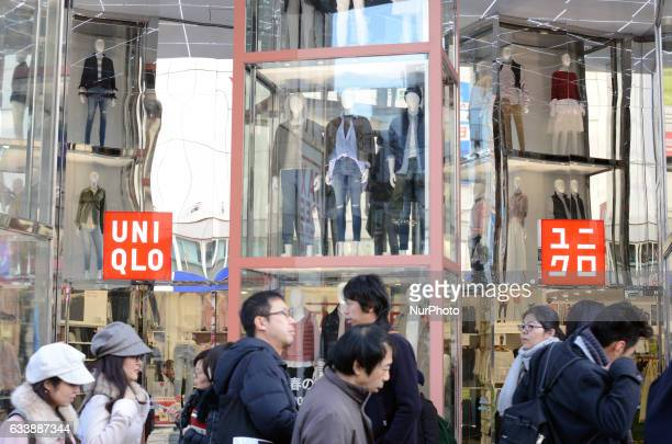 People walk past Japan's Fast Retailing Co Ltd's Uniqlo signboard at its shop in Tokyo Japan February 5 2017
