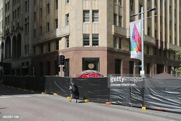 People walk past Lindt Cafe in Martin Place on December 17 2014 in Sydney Australia Sydney siege gunman Man Haron Monis was shot dead by police in...