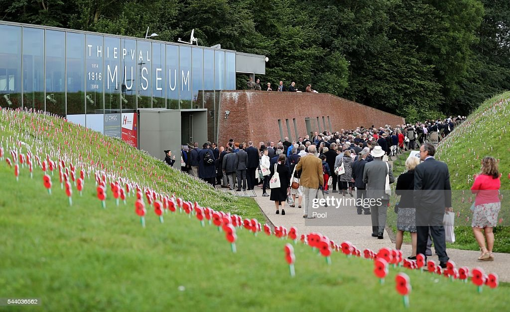 People walk past poppies as they enter the Thiepval Museum ahead of the 100th anniversary of the beginning of the Battle of the Somme at the Thiepval memorial to the Missing on July 1, 2016 in Thiepval, France. The event is part of the Commemoration of the Centenary of the Battle of the Somme at the Commonwealth War Graves Commission Thiepval Memorial in Thiepval, France, where 70,000 British and Commonwealth soldiers with no known grave are commemorated.