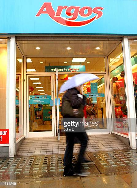 People walk past retail chain Argos January 8 2003 in London Big name retailers have reported slow sales before Christmas which continues despite...