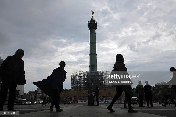 People walk past the Bastille column under renovation on September 19 2016 Renovation will last until 2018 and will allow visitor to visit the...