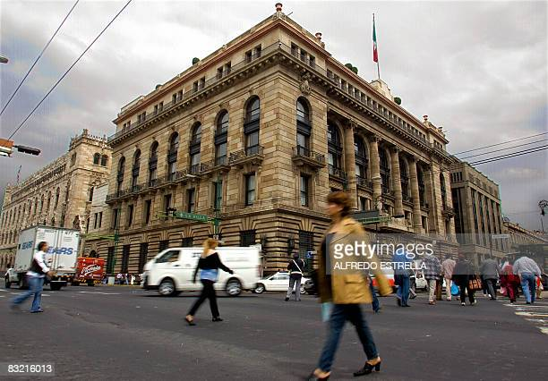 People walk past the Central Bank of Mexico in Mexico City on October 10 2008 The Mexican stock exchange is still showing losses as the financial...