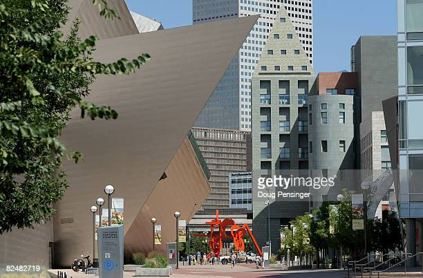 People walk past the Civic Center Cultural Complex which houses the Denver Art Museum the Denver Public Library the Colorado History Museum and the...
