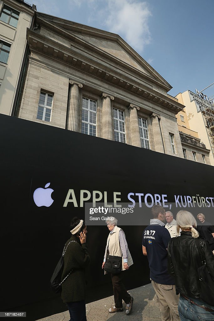 People walk past the construction site of the new Apple Store on Kurfuerstendamm avenue on April 22, 2013 in Berlin, Germany. The store is due to open in May and will the be the first Apple Store to open in the Germany capital.