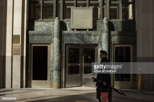 People walk past the contemporary New York eatery Eleven Madison Park on April 05 2017 in New York The restaurant was crowned the world's best...