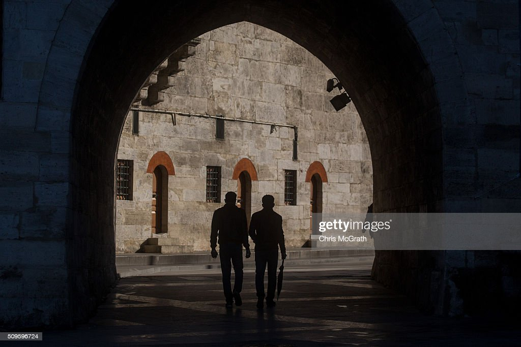 People walk past the Eminonu Mosque on February 11, 2016 in Istanbul, Turkey. Istanbul is famous for its skyline dotted with historic mosques, it is home to more than 3000 mosques, the most of any city in Turkey and includes the famous Blue Mosque and Suleymaniye Mosque.
