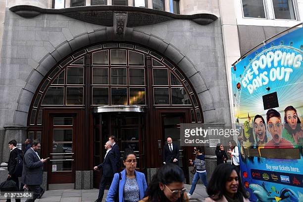 People walk past the entrance to the Goldman Sachs investment offices in Peterborough Court on October 10 2016 in London England A number of global...