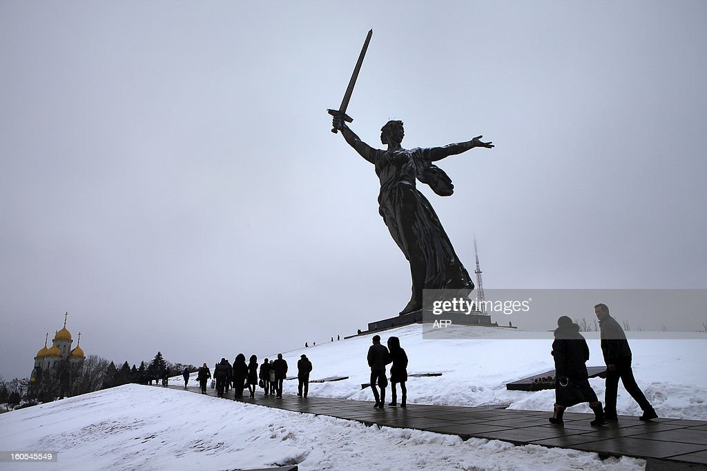 People walk past the giant monument 'Rodina-Mat' zovyot!''( Mother Motherland Is Calling for Fight) also known as Mother Motherland statue, at the memorial built to honour those who died in the Battle of Stalingrad during the World War II, in the Russian city of Volgograd, on Febuary 2, 2013. Russia marked today the 70th anniversary of a brutal battle in which the Red Army defeated Nazi forces and changed the course of World War II.