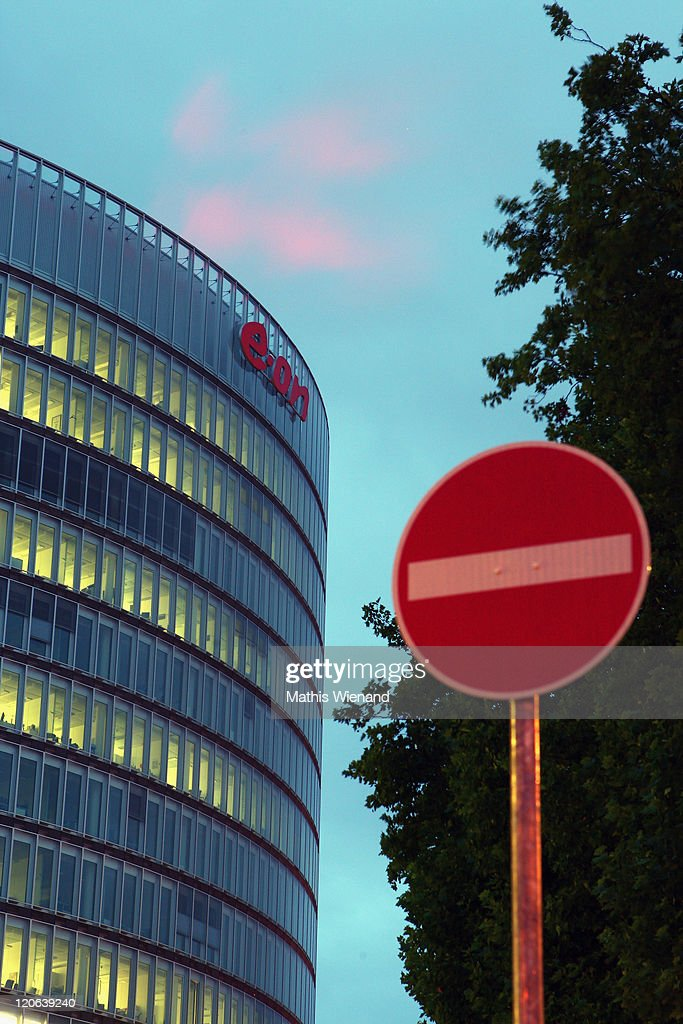 People walk past the headquarters of E.ON Ruhrgas, the natural gas subsidiary of E.ON, Germany's largest power company, on August 8, 2011 in Essen, Germany. The company recently announced it will close the recently-completed Essen facility as part of a worldwide reduction of 10,000 jobs due to a loss of revenue stemming from the decision of the government of German Chancellor Angela Merkel to phase out nuclear energy as well as the company's difficulties in the natural gas market. Germany has 17 nuclear power reactors, eight of which are operated by E.ON, that are scheduled to be phased out of operation by 2022.