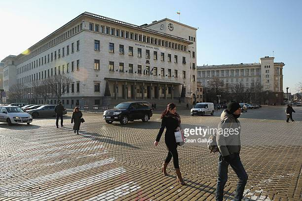 People walk past the headquarters of the Bulgarian National Bank in the city center on December 5 2013 in Sofia Bulgaria Restrictions on the freedom...