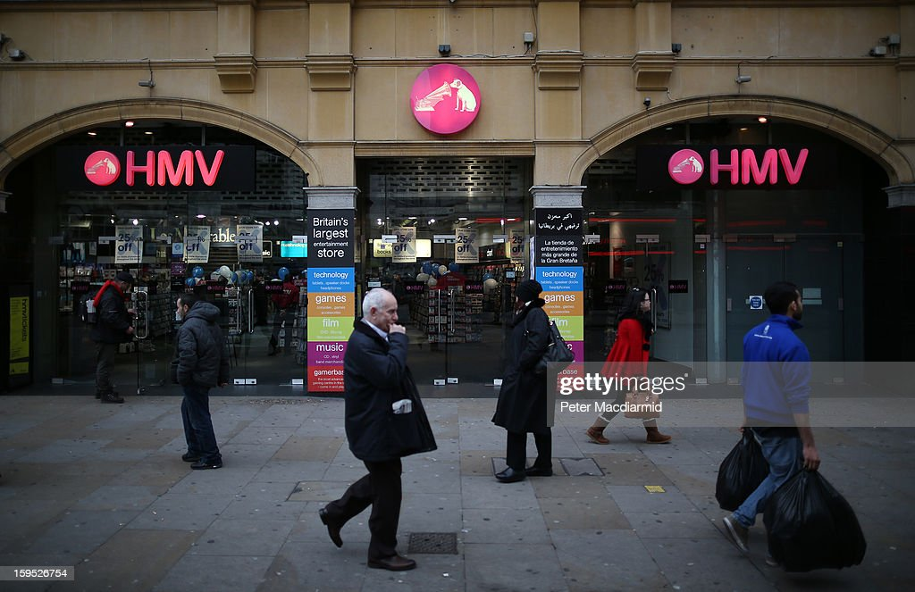 People walk past the HMV music and video shop in Piccadilly on January 15, 2013 in London, England. Management have announced that administrators have been called in which may put the 4350 staff at risk. HMV was founded in 1921 has 239 stores in the UK and the Republic of Ireland and has struggled to compete against online retailers.