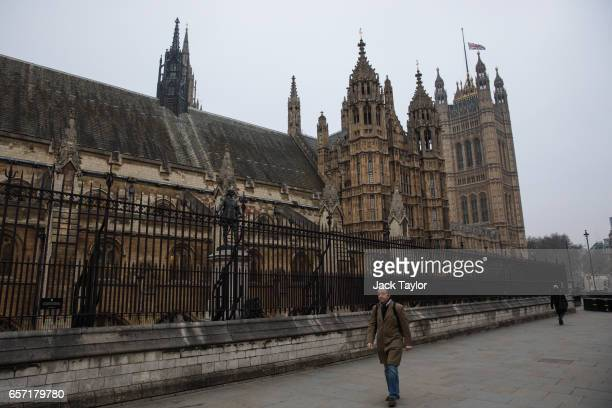 People walk past the Houses of Parliament after Parliament Square was reopened following Wednesday's attack on Westminster on March 24 2017 in London...