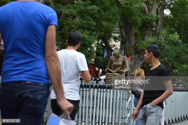 People walk past the Human Rights Statue under a police barricade on Yuksel Street at Kizilay district in Ankara Turkey on July 05 2017 The Ankara...