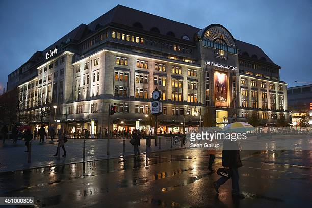 People walk past the illuminated KaDeWe department store on Kurfuerstendamm avenue on November 20 2013 in Berlin Germany Berlin with still over a...