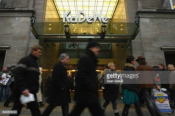 People walk past the KaDeWe department store during Christmas season shopping on December 16 2008 in Berlin Germany German retailers are hoping for...