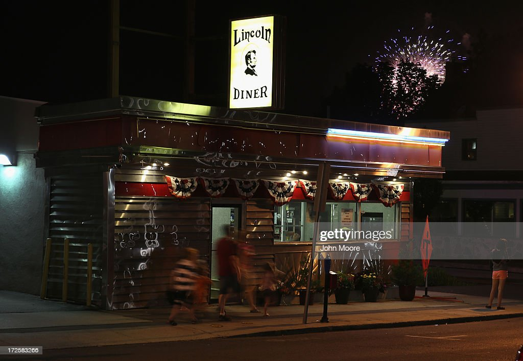 People walk past the Lincoln Diner during a fireworks display on the 150th anniversary of the historic Battle of Gettysburg on July 3, 2013 in Gettysburg, Pennsylvania. The battle, which took place July 1-3, 1863, is widely considered the turning point in the American Civil War. Federal and Confederate armies suffered a combined total of 51,000 casualties over three days, the highest number of any battle in the four-year war. President Lincoln came 3 1/2 months later to give his Gettysburg Address.