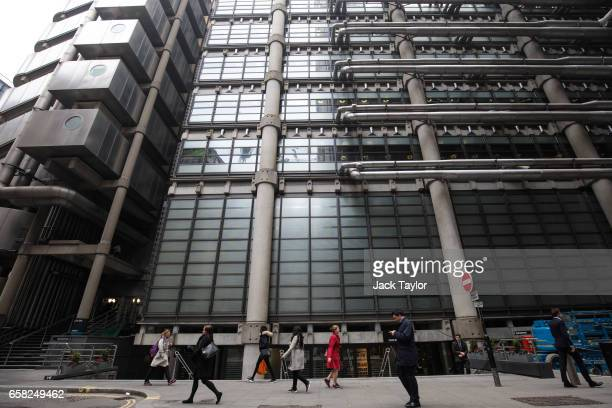 People walk past the Lloyd's building home of the world's largest insurance market Lloyd's of London on March 27 2017 in London England British Prime...