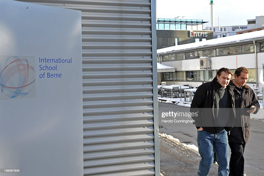 People walk past the logo of the International School of Berne on December 19, 2011 in Guemligen, Berne, Switzerland. Following the death of North Korean leader Kim Jong-il of a heart attack on 17 December, 2011 at the age of 69, his third son Kim Jong-Un is expected to succeed his father. Kim Jong-Un is believed to have studied at the International School of Berne, under a pseudonym, which provides education for 280 students of diplomatic, academic and business families of over 40 nationalities.