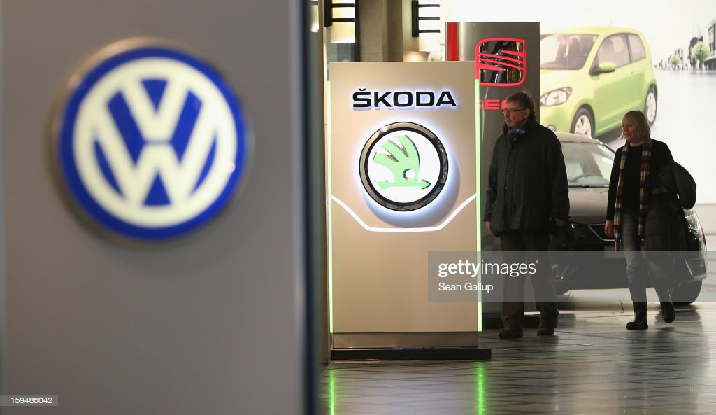 People walk past the logos of Volkswagen, Skoda and Seat at a Volkswagen Group showroom on January 14, 2013 in Berlin, Germany. Volkswagen Group, which includes the VW, Audi, Porsche, Skoda, SEAT, Bentley and Bugatti brands, delivered a record 9.07 million cars to customers in 2012. Rising sales in the Americas and Asia helped to offset a drop in sales in western Europe.