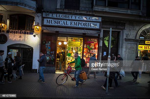 People walk past the main entrance of Musical Emporium store during its last day open to the public on January 5 2015 in Barcelona Spain Musical...