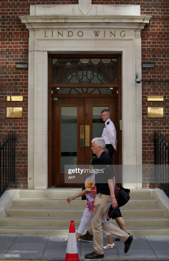 People walk past the main entrance to the Lindo Wing of Saint Mary's Hospital in Paddington, west London on July 9, 2013. Prince William and his wife Catherine's baby, which will be third in line to the throne, will be born in the private Lindo wing of St Mary's Hospital, where William was born in 1982 and his brother Harry in 1984.
