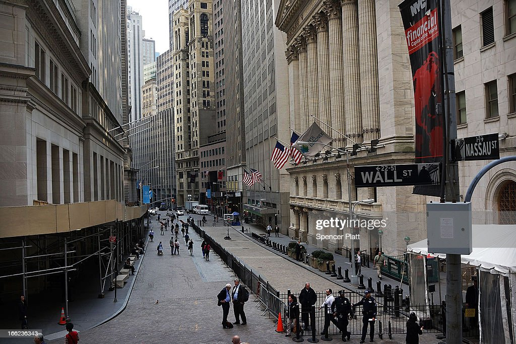 People Walk past the New York Stock Exchange on April 10, 2013 in New York City. The Dow Jones industrial average hit a new trading high of 14,826.66 Wednesday, moving up 0.9%.