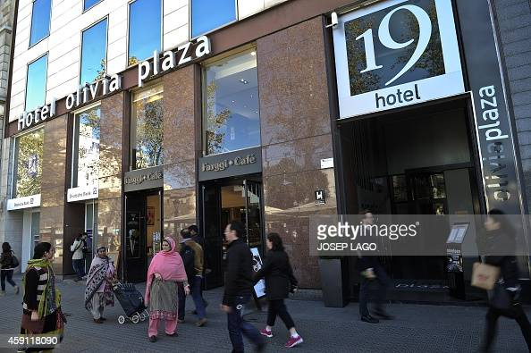 People Walk Past The Olivia Plaza Hotel In Barcelona On November 17