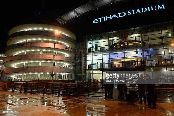 People walk past the outside of the Etihad Stadium in Manchester northwest England on February 12 2014 after the English Premier League football...