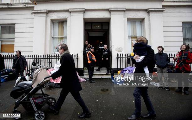 People walk past the pound15 million Grade II listed mansion on Belgrave Place London which has been squatted by the Autonomous Nation of Anarchist...