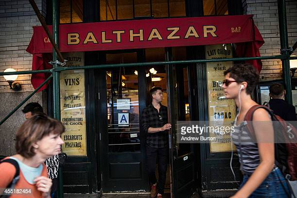 People walk past the restaurant Balthazar near the construction site at 42 Crosby Street which is being developed into a luxury apartment building...