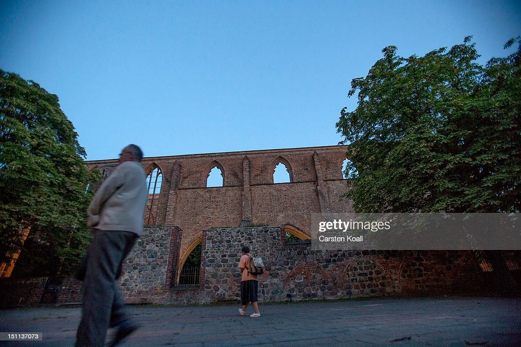 People walk past the ruins of the abbey, once the most important Gothic building in Berlin on September 1, 2012 in Berlin, Germany. The church is part of ongoing exhibitions and events ahead of Berlin's 775th anniversary, which the city will mark with a celebration scheduled for the end of October.
