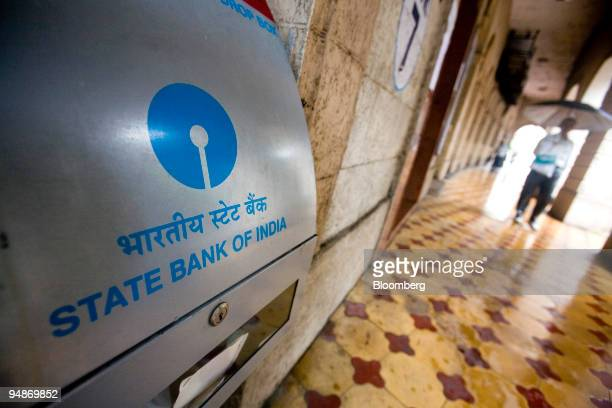 People walk past the State Bank of India main branch office in Mumbai India on Monday July 28 2008 State Bank of India reported the slowest profit...