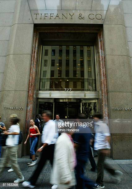 People walk past the storefront of Tiffany Co August 12 2004 in New York City The luxury jeweler announced on August 12 that quarterly profit fell 11...