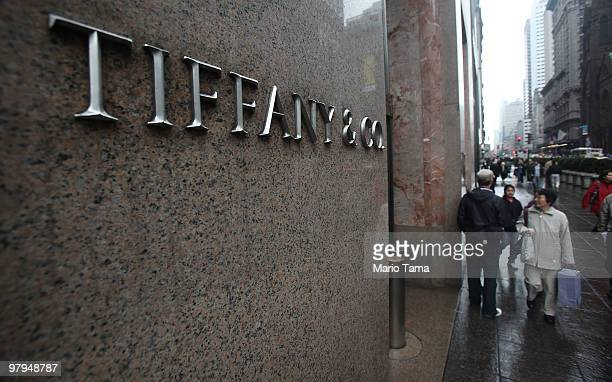 People walk past the Tiffany Co flagship store on Fifth Avenue March 22 2010 in New York City Jeweler Tiffany Co's fourthquarter profit quadrupled...