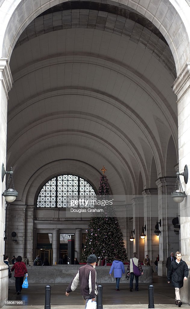 People walk past the Union Station Christmas Tree that is outdoors this year due to all of the construction going on inside the Great Hall. The tree was light on December 4th the same night as the U.S. Capitol Christmas tree was lit by Speaker of the House John Boehner