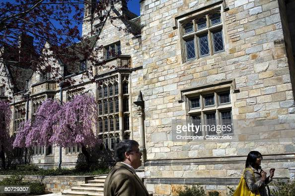 People walk past the visitor's center on the campus of Yale University April 15 2008 in New Haven Connecticut New Haven boasts many educational and...