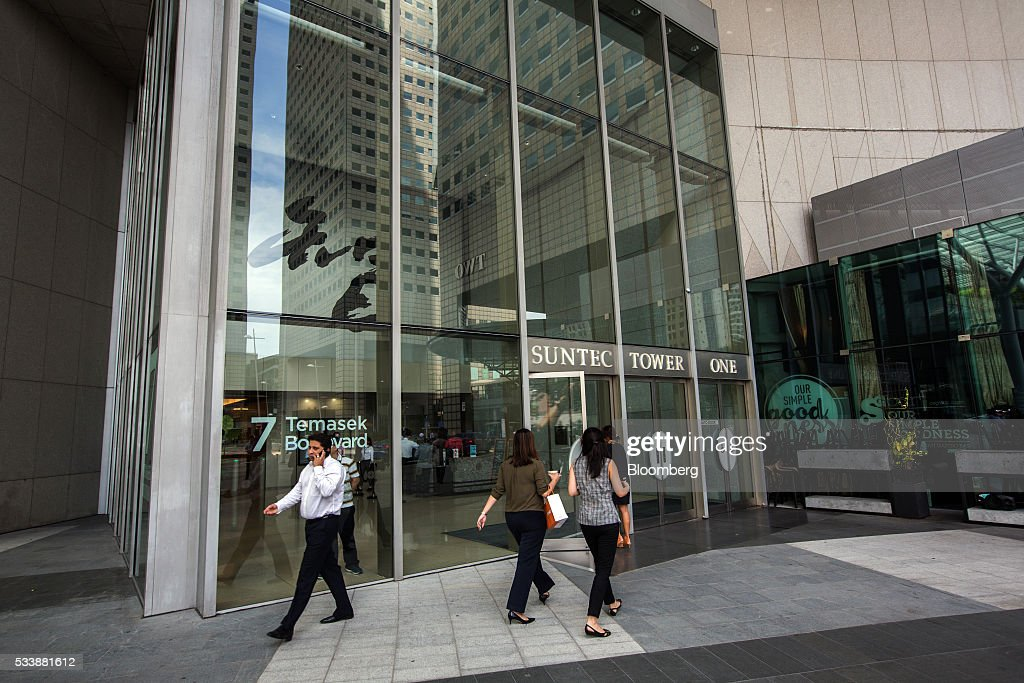People walk past Tower One of Suntec City, left, which houses the headquarters of BSI Bank Ltd., in Singapore on Tuesday, May, 24, 2016. Singapore ordered BSI SAs unit in the city-state to shut down as Swiss authorities began criminal proceedings against the bank, the biggest fallout suffered by a financial institution to date from global probes related to a troubled Malaysian state fund. Photographer: Nicky Loh/Bloomberg via Getty Images