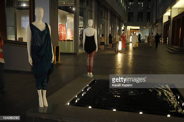 People walk past trendy boutiques in Dubai International Financial Centre The DIFC is the world's fastest growing international financial centre It...