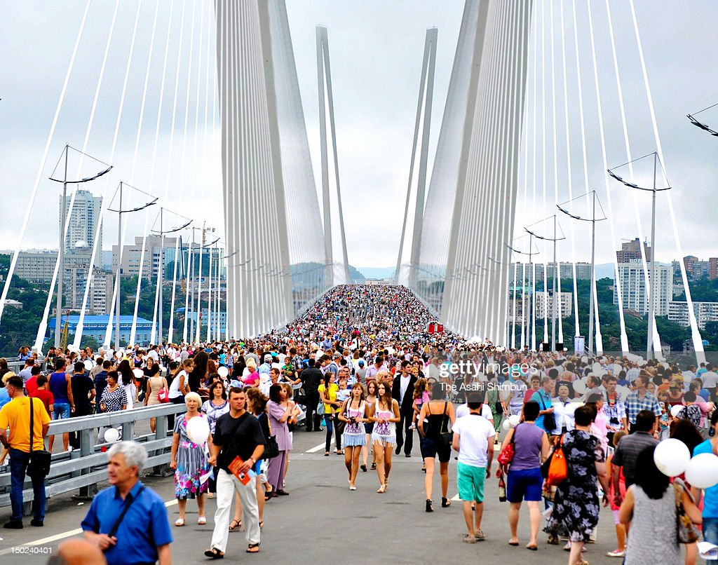 People walk the cable stayed bridge over Golden Horn Bay on August 11, 2012 in Vladivostok, Russia. The bridge was built as a part of the APEC preparation.