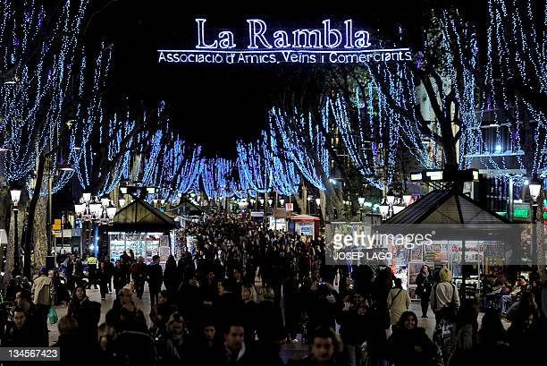 People walk the Christmas illuminations at La Rambla of Barcelona on December 2 2011 Streets of the Barcelona are decked out in lights every year...