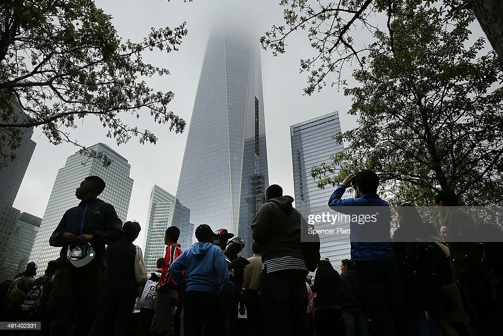 People walk the grounds at the Ground Zero memorial site after authorities opened the plaza to the public free of charge on May 16, 2014 in New York City. Prior to today, visitors had to wait in line to enter a barricaded area which includes the newly dedicated National September 11 Memorial Museum. Together with the museum, Ground Zero has become one of the top tourist attractions in the nation with tens of thousands of visitors expected yearly.