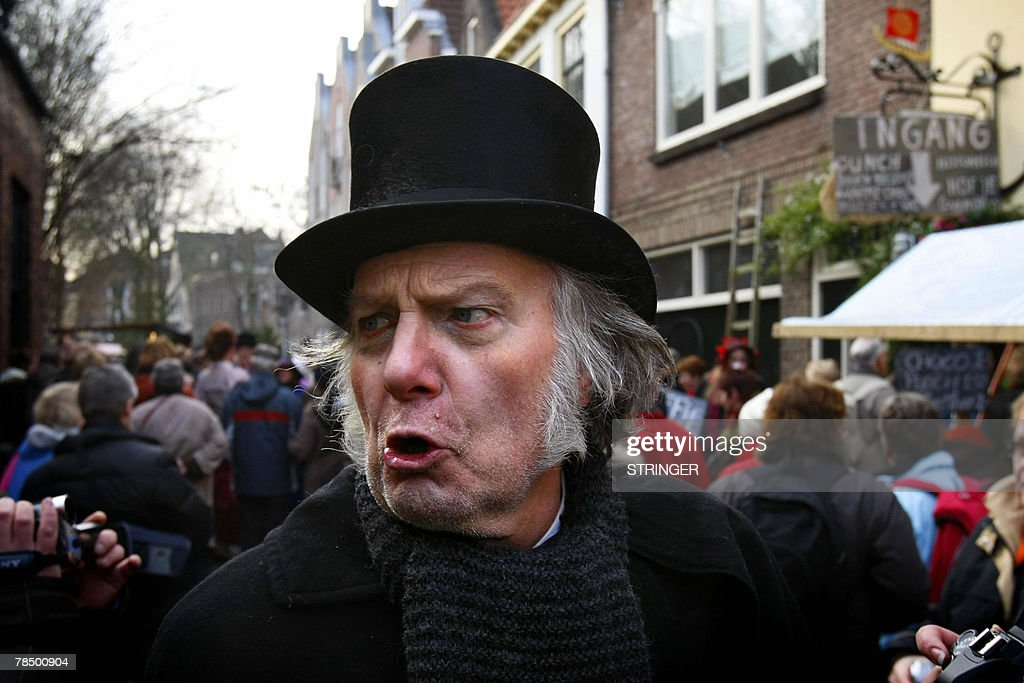 People walk the streets of Deventer in period costumes during the Dickens Festival 15 December 2007 portraying characters from the novels of the...