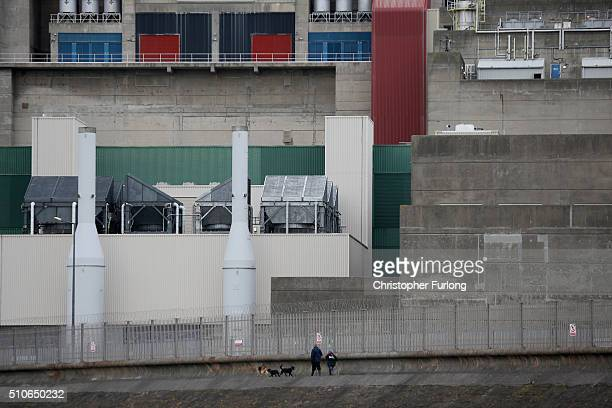 People walk their dogs past the Heysham 2 nuclear power station on February 16 2016 in Heysham England French energy provider EDF has announced that...