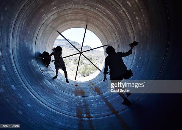 People walk through a Hyperloop tube after the first test of a propulsion system at the Hyperloop One Test and Safety site on May 11 2016 in North...