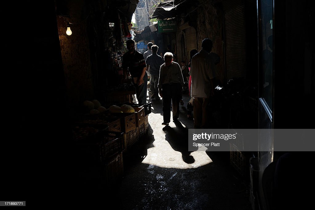 People walk through a market on June 29, 2013 in Tripoli, Lebanon. Tripoli, Lebanon's second largest city, has suffered from the spillover of Syria's two-year-old war. In the past month alone, over 30 people have been killed in Tripoli in battles between pro-Syrian government partisans against those supporting the Syrian rebels. Currently the Lebanese government officially hosts 546,000 Syrians with an estimated additional 500,000 who have not registered with the United Nations. Lebanon, a country of only 4 million people, is now home to the largest number of Syrian refugees who have fled the conflict. The situation is beginning to put a huge social and political strains on Lebanon as there is currently no end in sight to the war in Syria.